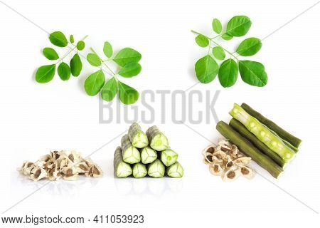 Set Of Moringa Leves, Seeds And Pods Isolated On White Background, Herb And Medical Concept