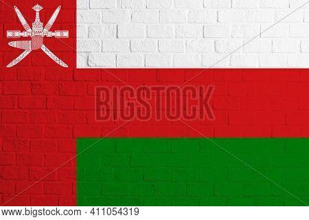Flag Of Oman. Brick Wall Texture Of The Flag Of Oman.