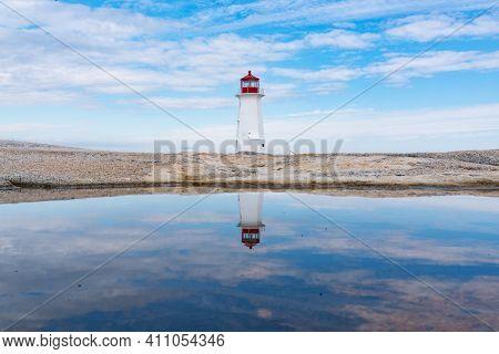 Reflection Of Peggy's Point Lighthouse Near Peggy's Cove, Nova Scotia, Canada