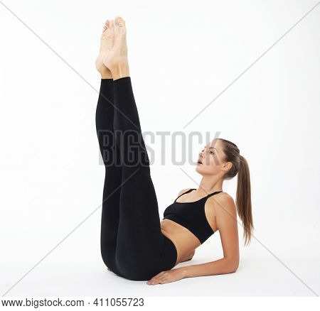 Yoga, fitness and sport concept - Beautiful young woman doing yoga, isolated on white background