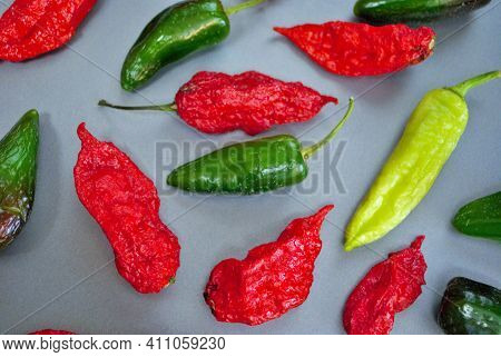 Fresh Jalapeno Habanero And Banana Pepper On A Silver Background