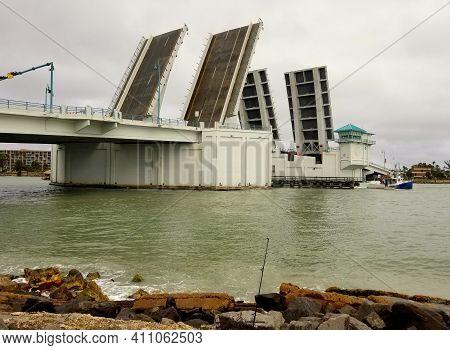 Madeira Beach, Florida, U.s.a - February 20, 2021 - The Drawbridge Opened For A Ship By The Canal