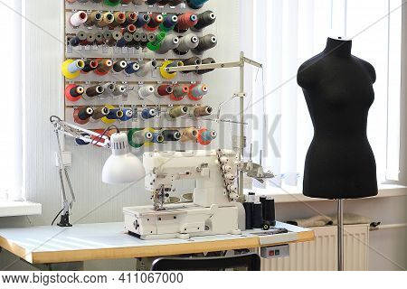 Shot Of Seamstress Workplace. Fashion Design Studio. Sewing Machine And Various Sewing Related Items