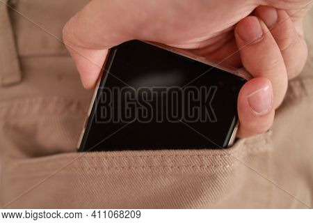 Mobile Phone In Brown Khaki Denim Jeans Pant Pocket, Pocketing Smartphone Concept