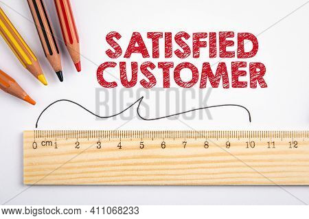 Satisfied Customer. Survey, Statistics And Analysis Concept. Colored Pencils And Wooden Ruler