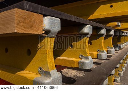Stacked Formwork Made Of Yellow Wooden Beams And Plywood Sheets Using For Concrete Cast In Place Wor
