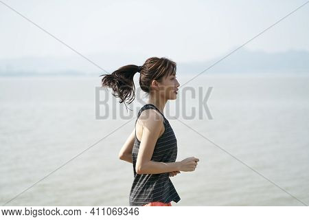 Young Asian Woman Female Runner Running By The Sea, Black And White