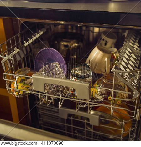 Closeup Of A Dishwasher Full Of Clean Spotless Dishware, Indoor Closeup