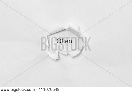 Word Often On White Isolated Background, The Inscription Through The Wound Hole In Paper. Concept Of