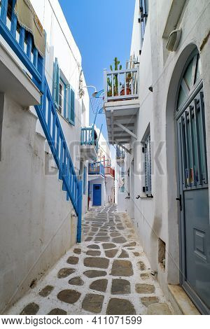 Traditional Narrow Cobbled Streets, Beautiful Alleyways Of Greek Island Town. Whitewashed Houses, Fl