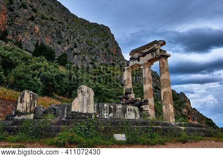 Ruins Of Tholos Of Ancient Greek Goddess Athena Pronaia In Delphi, Greece. Restored Three Doric Colu