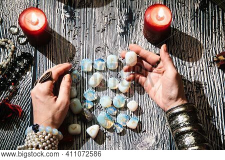 Fortunetellers Hands With Stone Runes, Top View. Prediction Of The Future. Mystic Interior. Occult S