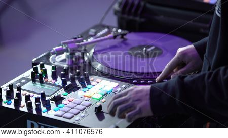 Close-up Of Professional Dj Working Behind Mixer. Art. Cool Dj Quickly Switches Buttons On Mixer. Pr
