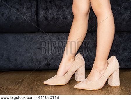 Pretends To Be An Adult. Close-up Shot Of Boy's Feet In Oversized High-heeled Shoes With Copy Spacen