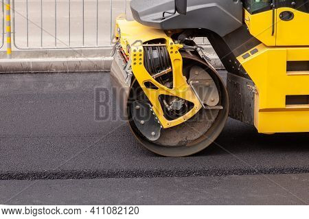 Close Up Large Road-roller Paving A Road. Road Construction