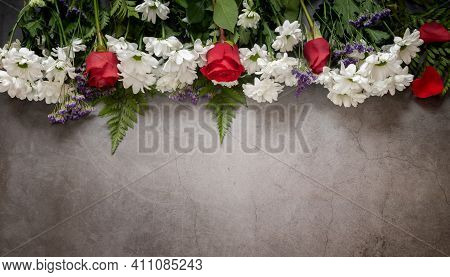 Beautiful Flowers Of White Chrysanthemums And Red Roses On A Dark Background. Top View, Copy Space