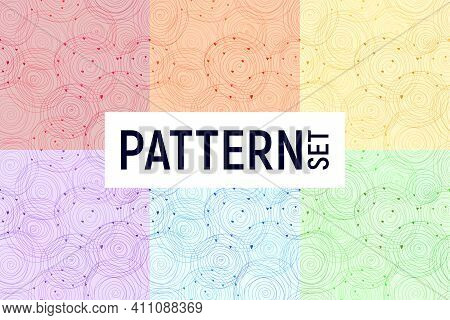 Vector Set Of Multi-colored Seamless Patterns With Rainbow Colored Doodle Spiral Circles On A White