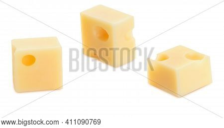 Portions (cubes, Dice) Of Emmental Swiss Cheese. Texture Of Holes And Alveoli. Isolated On White Bac