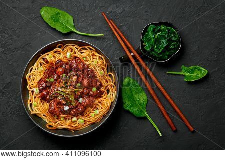 Bakmi Or Mie Ayam In Black Bowl On Dark Slate Table Top. Indonesian Cuisine Noodles Meat Dish. Tradi