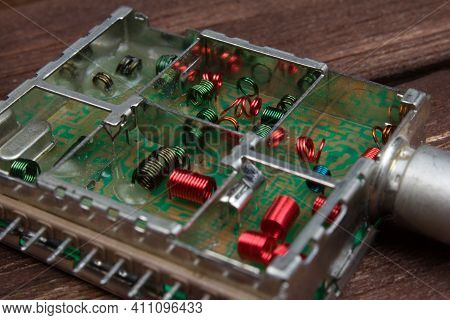 Electromagnetic Air-core Inductors For High Frequencies On Circuit Board Panoramic Background.