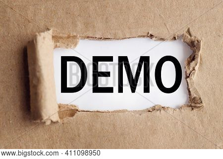 Demo. Interest. Text On White Paper Over Torn Paper Background.