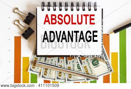 Inscription Absolute Advantage In Notebook, Concept Planning, With Office Tools ,chart And Dollars