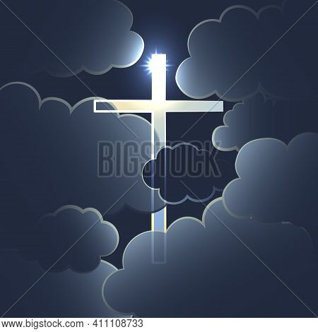 The Silhouette Of A Shining Cross In A Dark Cloudy Sky