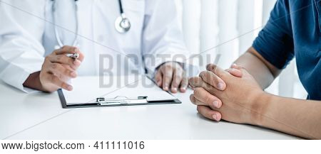 Doctors Hold Pen Are Discussing To Serious Patient For Their Symptoms, Doctor To Advice About Treatm