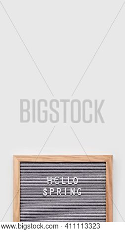 Grey Letterboard With Seasons Greeting Hello Spring And Symbol Of Usa Dollar And Euro Currency. Vert