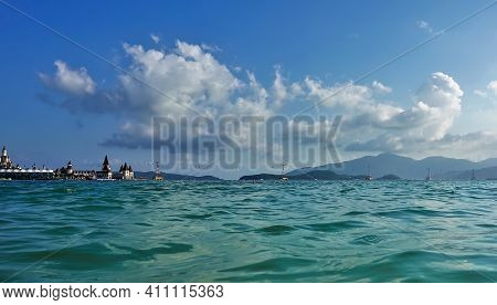 Above The Turquoise Surface Of The Sea Are The Pillars Of The Cable Car From The Mainland To The Isl