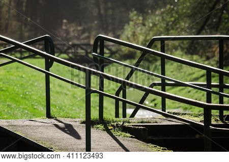 Handrails On The Causeway - Infrastructure  Of A Walking Trail By A Brook In The Park