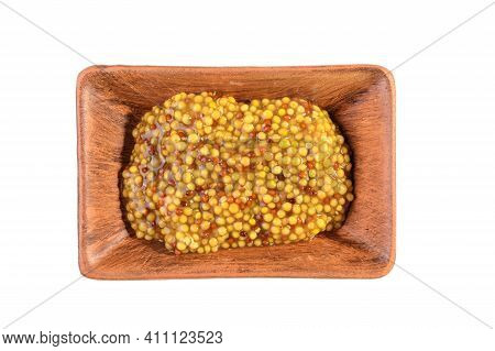 Whole Grain Mustard In A Clay Saucepan. French Mustard Is Isolated On A White Background.top View
