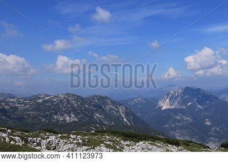 Experienced Parachutist Flies In The Right Wind And Drives A Parachute Around The Austrian Alps. Par