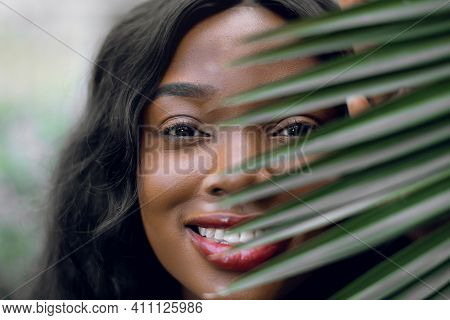 Beauty Face, Skin Care, Tropical Nature. Close Up Of Smiling African American Lady Model With Natura