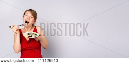 Long Banner With A Beautiful And Cheerful Young Blonde Woman Enjoying Sushi And Having Fun Eating Wi