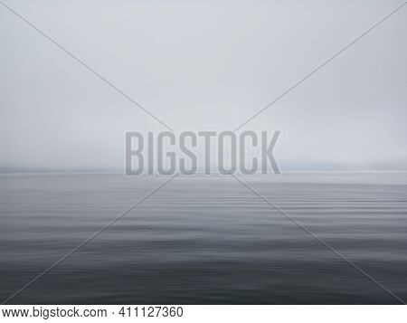Minimalism Scene Of Misty Morning Background In The Sea. Fog Over Lake Wave Water. Calm Beach View.