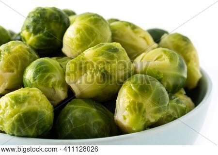 Set Of Brussel Sprouts In A Bowl Isolated On White Background. Close Up