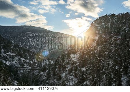 Winter Mountains. Wonderful Winter Landscape With Sunshine. View Of The Snow-covered Forest Slope Of