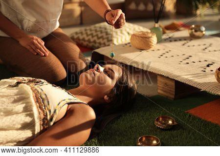 Woman At Crystal Healing Session Indoors, Closeup