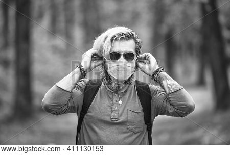 Man Protecting From Air Contamination Or Coronavirus Covid-19 By Wearing Mask. Avoid Infection. Male