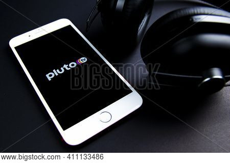 Spain. 03, 05, 2021. Pluto Tv App Icon In An Iphone With Eardphones. Pluto Tv Is A Free Live-stream