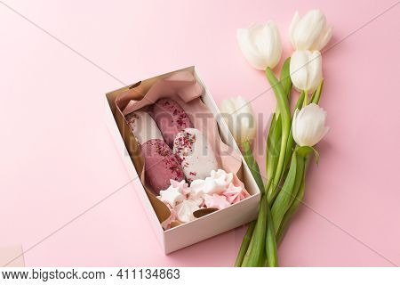 Delicious Handmade Ice-cream In A Gift Box Isolated On Pink Background With White Tulips. Sweet Pres