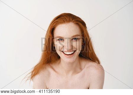 Skincare And Beauty. Close-up Of Beautiful Pale Redhead Female Posing Naked On White Background, Smi