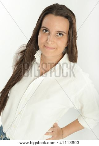 Smiling long haired brunette in a white shirt