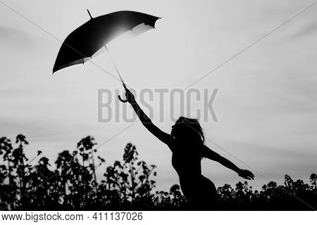 Unplugged Free Silhouette Woman Umbrella Up To Black White Sky. Nature Girl At Windy Rainy Day Has A