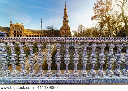 Plaza De Spain In Seville, Ceramic Balustrade Over The Water Channel Of The Square And Historic Buil