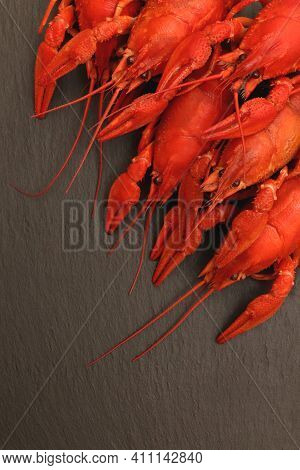 Red Boiled Crayfishes Food. Shellfishes Delicious Lunch. Cooked Red Crayfishes On Black Stone Backgr