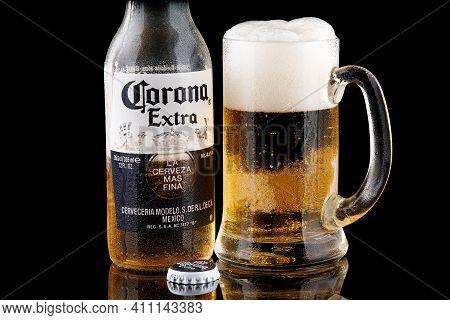 Lviv, Ukraine - June 02, 2020: Beer Corona And Glass On A Black Background