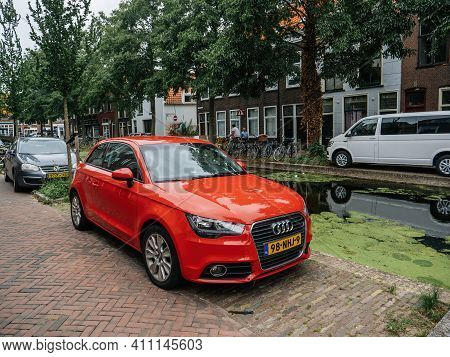 The Netherlands - Aug 19, 2018: Brand-new Audi Car Parked On Dutch Street Near Water Canal