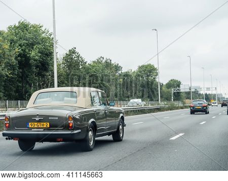 The Netherlands - Aug 19, 2018: Luxury Beautiful Vintage Rolls-royce Silver Wraith Ii Driving On Dut